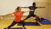 A couple practising Yoga